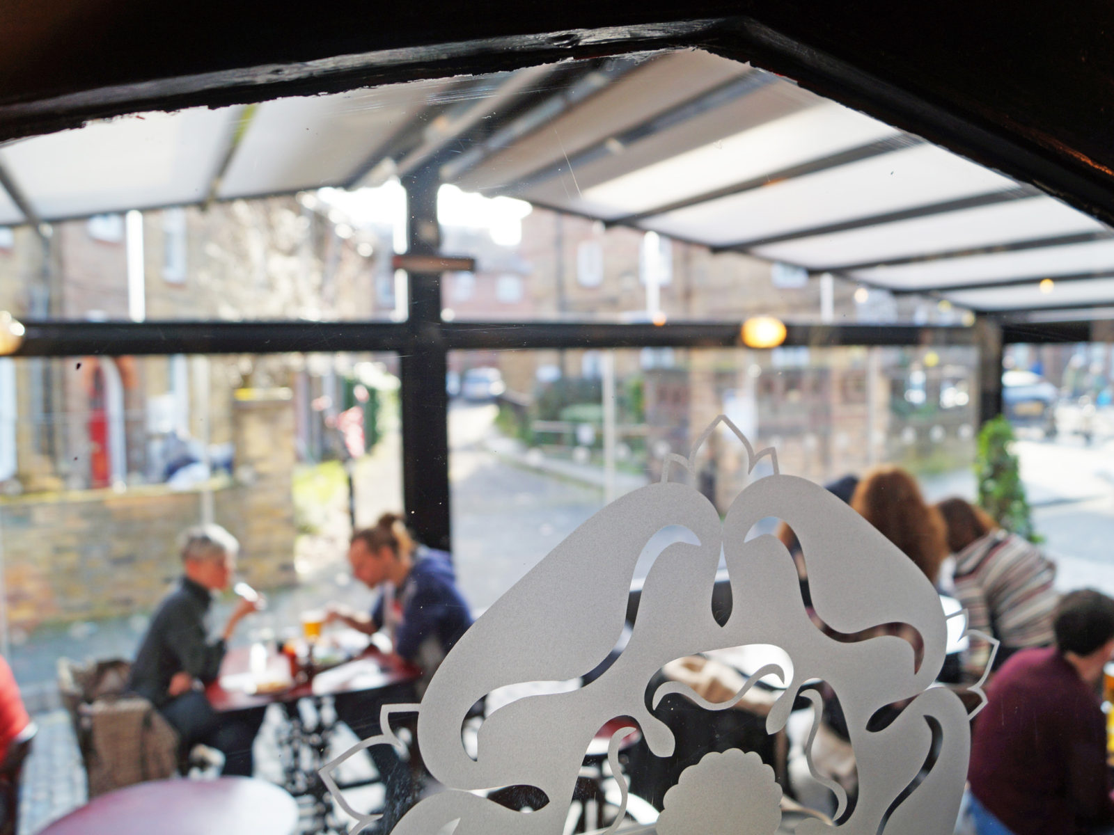 The view into our conservatory. Did you know we have space heaters so even in the colder months it is always cosy.